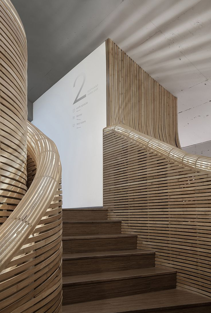 multidisciplinary architecture studio, head by cui shu, redesigns the elephant-parade headquarters in beijing by incorporating a giant bamboo staircase.