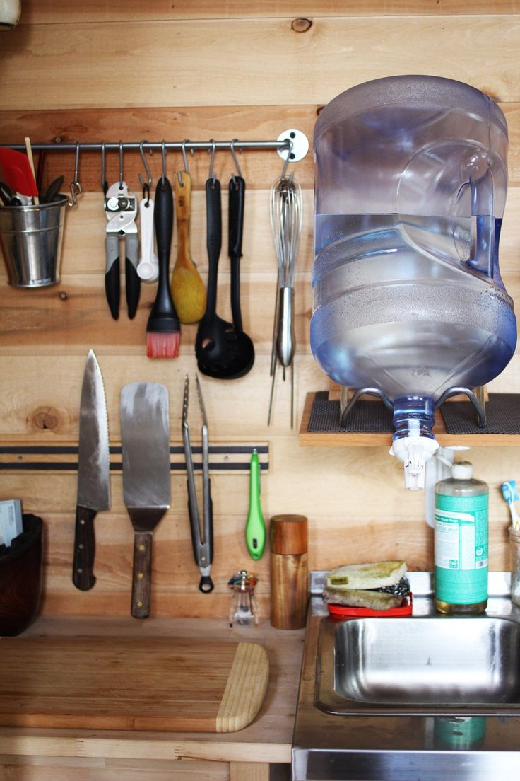 Tim and Hannah's Affordable DIY Self-Sustainable Micro Cabin - hang cooking utensils and use magnet strips for other cooking tools