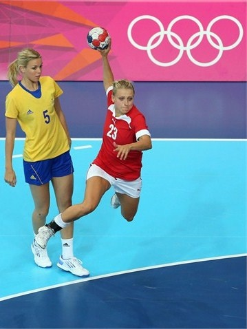 Trine Troelsen of Denmark scores a goal in the women's Handball  Trine Troelsen of Denmark scores a goal in the women's Handball preliminary group B match between Denmark and Sweden on Day 1 of the London 2012 Olympic Games at the Copper Box on 28 July 2012.