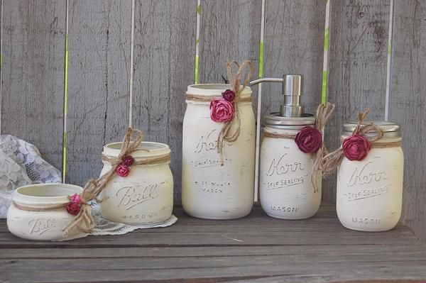 Shabby chic mason jar bathroom set. Hand painted in soft ivory, tied with jute and a orchid and deep pink roses, finished with a protective coating. Metal soap