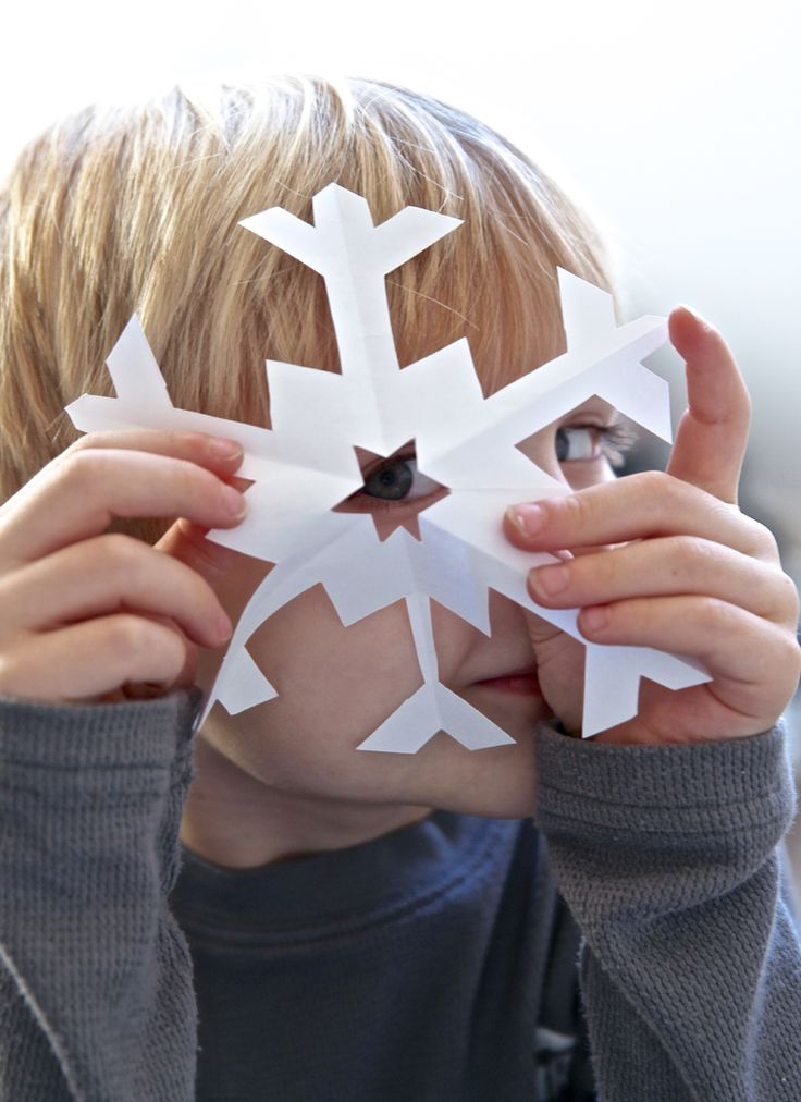 My kids love to cut out snowflakes using the good, old method where you fold up paper and cut out a bunch of chunks then open it up to reveal the surprising shape. It's fun to wonder as you are cut...