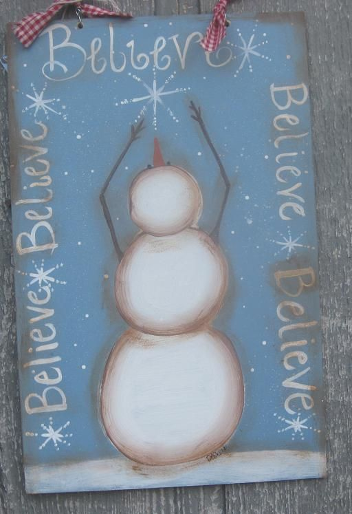 snowman looking up at snowflake sign I painted