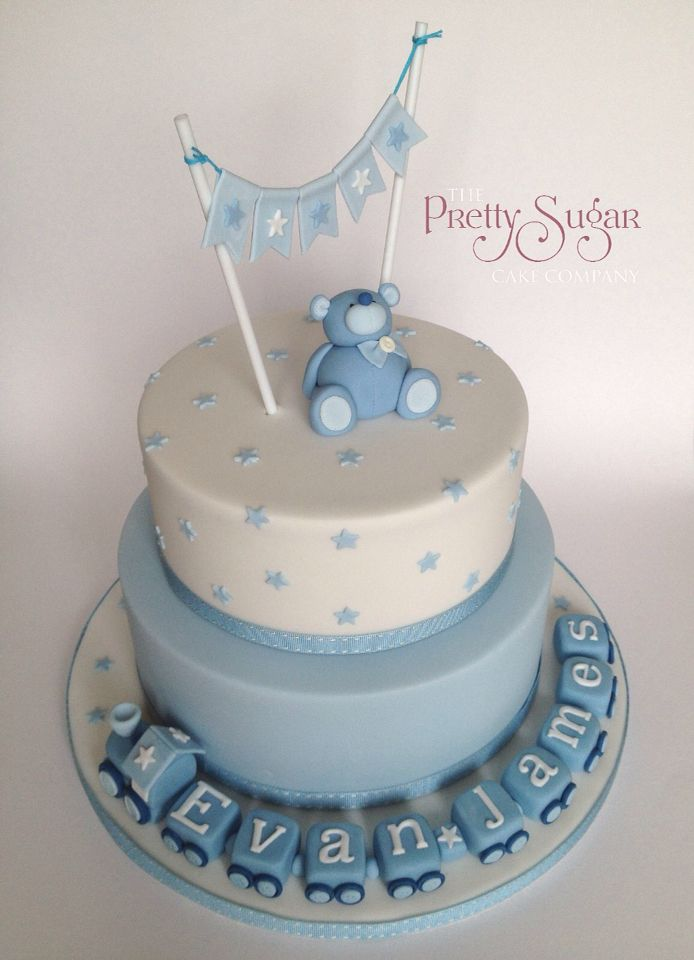 Blue and white christening cake with teddy, train and bunting detail