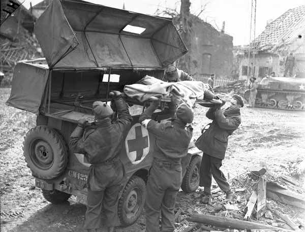 Jeep 4x4s were often used as make-shift ambulances in World War II. This set-up actually provided some protection from the elements.