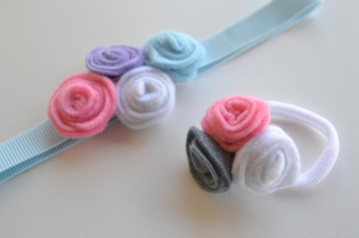 Light blue elastic head band with felt flowers