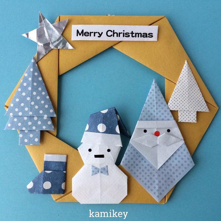 """「こまごま市」展示作品より。黄×青のクリスマスもありかと^ ^各折り紙作品の折り方はプロフィールにリンクがあるYouTube""""のkamikey origami """"チャンネルでご覧ください(ブーツは試作です)   Hexagonal wreath Star Fir tree  Mustache santa  Snowman  Santa hat designed by me Tutorial on YouTube"""" kamikey origami"""" #折り紙#origami #ハンドメイド#kamikey"""