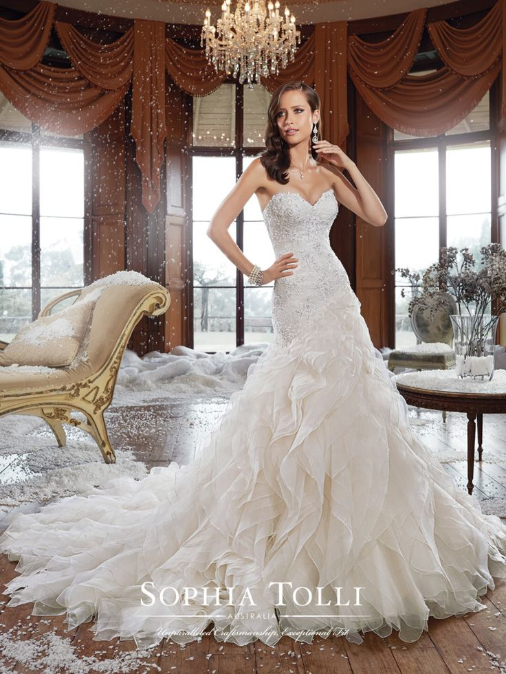 Sophia Tolli - Y21511 – Cameron - Fantasy organza ruffle wedding dress with asymmetrically dropped waist, A-line gown with strapless sweetheart neckline, hand-beaded lace appliqués, back corset and chapel length train. Removable spaghetti and halter straps included. Also available with a back zipper as style Y21511ZB. Click to view more organza ruffle wedding dresses.Sizes: 0 – 28Colors: Light Gold, White, Ivory, Diamond White