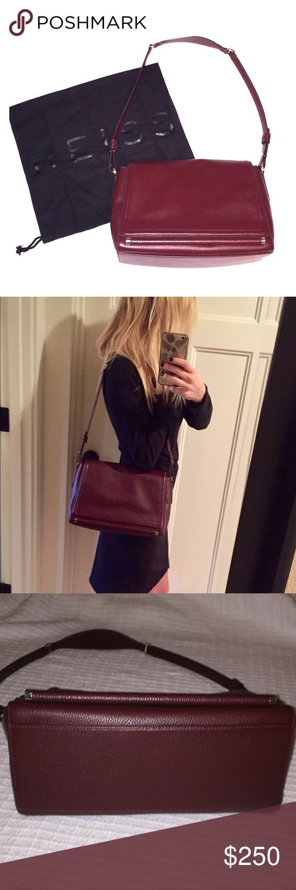 Reiss purse - leather shoulder bag Brand new, leather should bag. Dark maroon leather and black cloth interior. Comes with original storage bag. Has flap with magnetic closure and inside zipper. Reiss Bags Shoulder Bags
