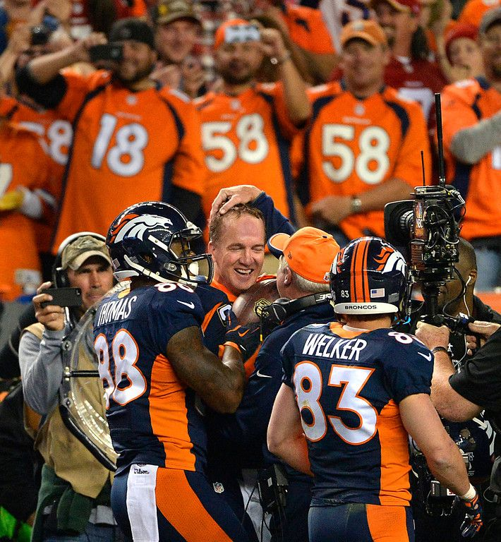 Peyton Manning (18) of the Denver Broncos is congratulated on the sidelines after his 509th career touchdown pass. The Denver Broncos played the San Francisco 49ers at Sports Authority Field at Mile High in Denver on October 19, 2014. (Photo by AAron Ontiveroz/The Denver Post)-- #ProFootballDenverBroncos