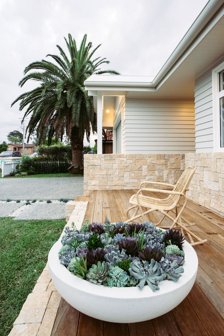 Sandstone, weatherboard, decking.
