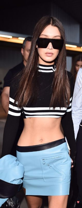 My ultimate girl crush Bella Hadid in 60s-style crop top and striped tipping with a powder blue patent skirt.