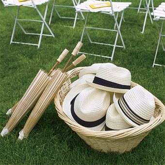 Save your guests with Fedora hats and rice-paper parasols: perfect sun protectors for a summer wedding. Photo Source; Brides. #parasols #menssunhats