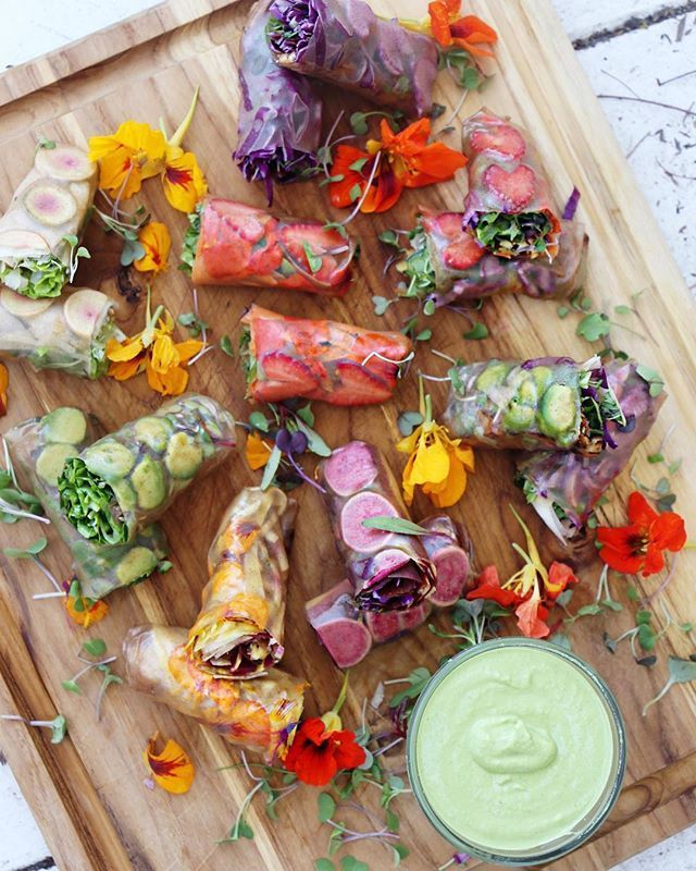RAINBOW RICE PAPER ROLLS with green pea & tahini dipping sauce You can fill these rainbow rice paper rolls with anything you like! We suggest fresh seasonal produce  fruits and veggies in season will have a higher nutritional content. We spent the morning at the local farmers market and sourced the following ingredients which we used to make our rainbow rice paper rolls! Recipe link in bio!