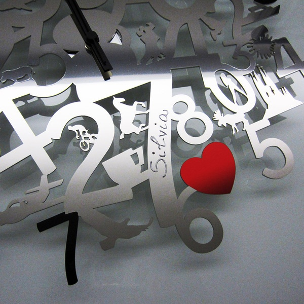 Wall clock inox steel laser-cutted. Perfect for a gift. Brand it with your name