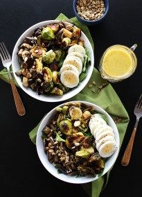 Brussels Sprouts Eggplant Buddha Bowl - Warm roasted veggies piled on top of greens! SO YUM! An easy & healthy recipe! Vegetarian/gluten free!