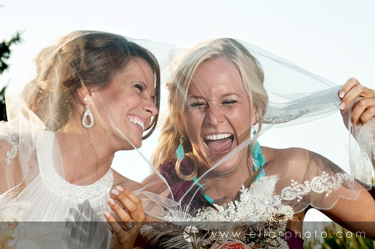 bride and maid of honor pose, funny bridesmaid photo, purple and teal wedding