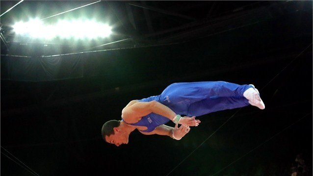 Paolo Ottavi of Italy dismounts the horizontal bar in the Artistic Gymnastics Men's Individual All-Around final on Day 5.