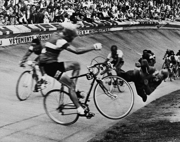 """Last Lap of the 1958 Tour de France  Original caption: Editor's notes: Paris, July 19, 1958. 45th """"Tour de France"""" (Brussels-Paris). Dramatic fall of the French rider Andre Darrigade (who'd already won 5 laps) on the Parc des Princes track, at the arrival of the 24th and last lap disputed between Dijon and Paris. He slams into a track official who was too close to the track."""