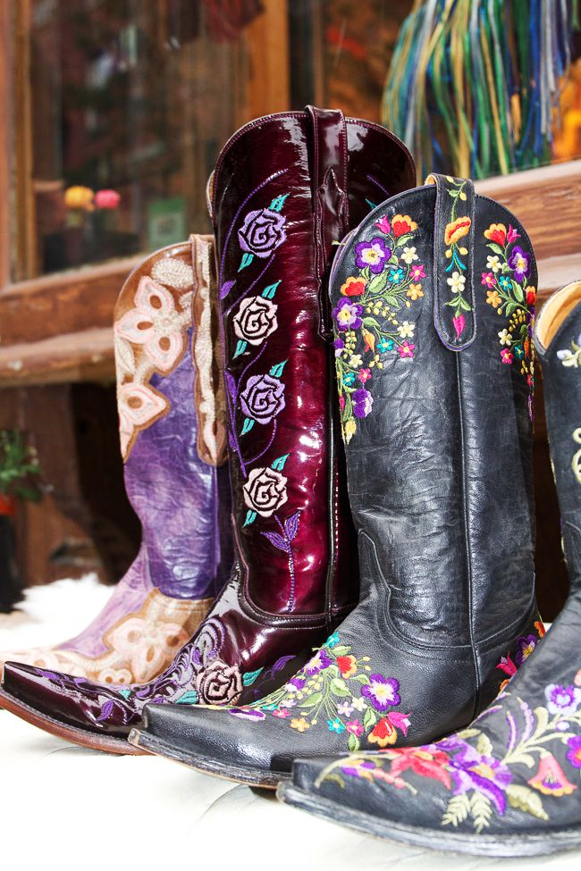 Bold purple and black cowboy boots at Space Cowboy NYC