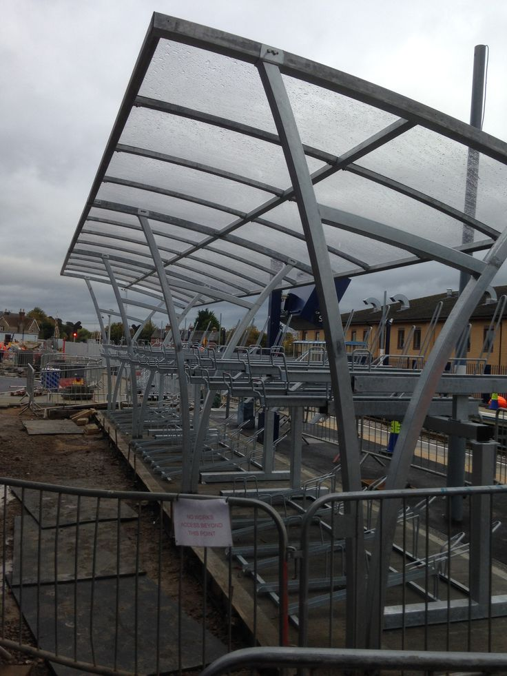 Bicester Town Station - FalcoRail Cycle Canopies with Two-Tier Racks to accommodate 60 bikes.