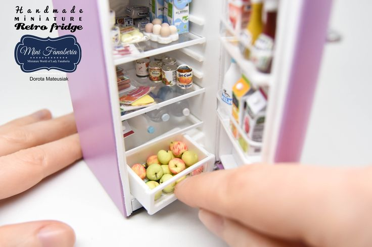 A retro refrigerator with opening door, pull out crispers, working lamp, metal hinges, magnet door latch, metal cover. Entirely made by me in 1:12 scale. Painted in cold pink color.