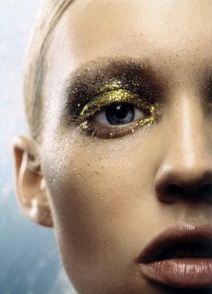Glittery gold and black eyeshadow eye makeup.