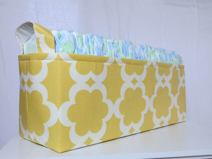 Diaper Caddy, baby caddy, Fabric Basket bin, Fits 50 size 1 diapers 15 x 5 x 6 by DivasIntuition on Etsy https://www.etsy.com/listing/110693144/diaper-caddy-baby-caddy-fabric-basket
