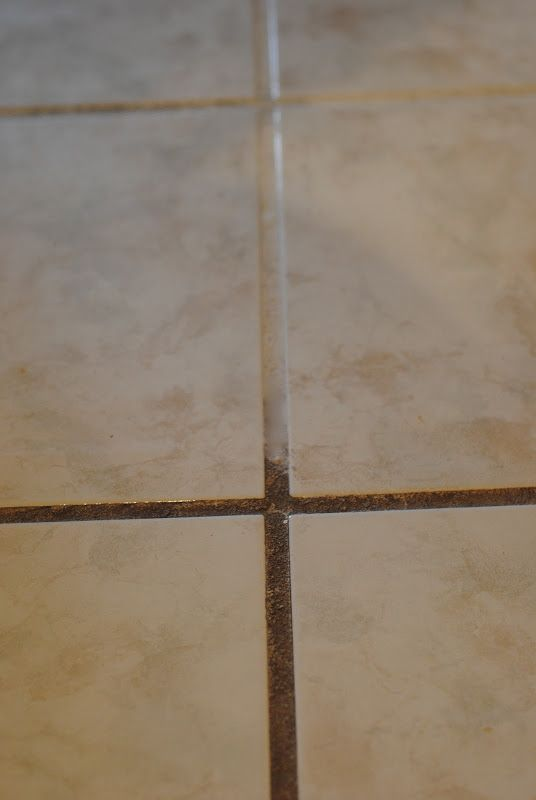 You need to see this before and after-- YES, you CAN clean grout safely using just two items I'm sure you already have in your home! Check out this quick tip and see how you can get clean grout in minutes flat! #greencleaning #grout