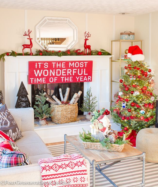 Our rustic red Christmas playroom / study/ place I like to hide! Try hanging a sign on your mantel to add a wow factor. Mixing simple red ornaments from HomeGoods (sponsored) with the family ornaments created a fun tree for the kids this year. Adorable red deer and Nordic Throw from HomeGoods