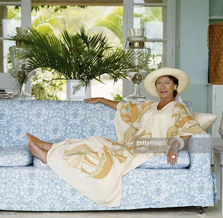 HRH The Princess Margaret reclining on a sofa at her home, Les Jolies Eaux, on Mustique in the West Indies in April 1976. (Photo by Lichfield/Getty Images).