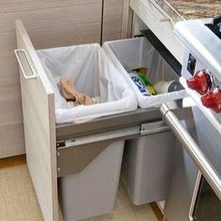 Don't want large bulky trashcans to be seen in the kitchen? Try installing these trash can drawers! #storage #kitchen #remodel by classichomeimprovements