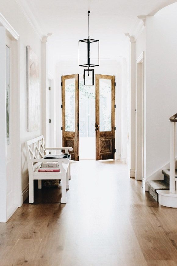 Gorgeous entry with white walls and hardwood floors