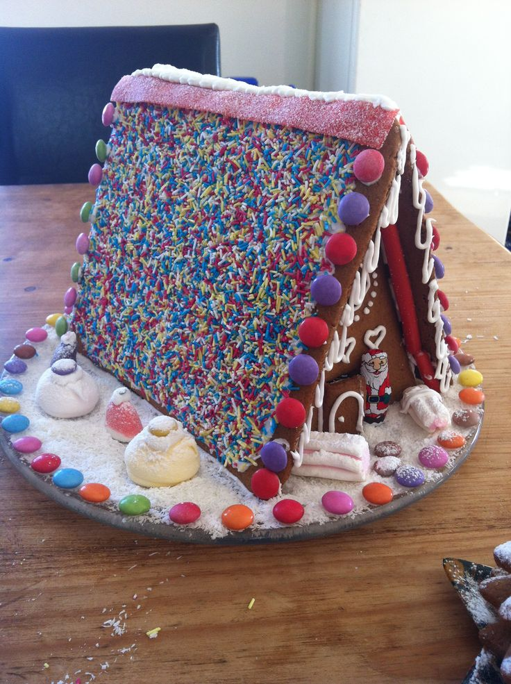 Christmas Baking- Gingerbread House. Free form all the pieces no template needed. Decorate with hundreds of thousands for roof and dessicated coconut for snow.