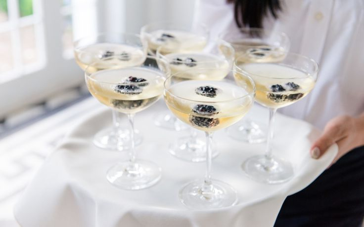 Blackberries add a sophisticated touch to passed champagne | Lowndes Grove Plantation in Charleston, South Carolina | Photo by Dana Cubbage