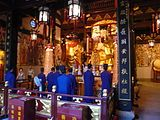 Altar inside the City God Temple of Shanghai with Taoist priests performing ritual