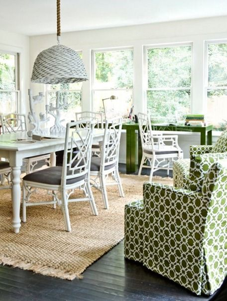 sisal rug, white faux bamboo chairs, green geometric print on chairs. melanie turner.