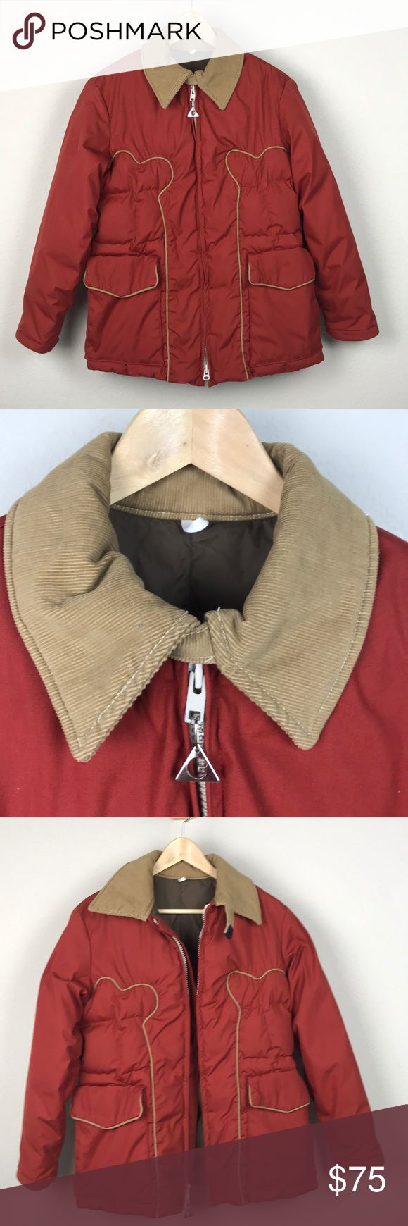"""VTG Gerry Burnt Orange Western Down Coat USA VTG Gerry burnt orange and tan corduroy down filled winter coat with western styling trim on front and back, corduroy collar, two front pockets, and a big thick zipper up the front. A Denver, CO brand, this jacket truly shows off Denver's """"Cow Town"""" history, and fits right in with the early 80s Stranger Things look I am obsessed with. Great vintage condition, only some red color transference on the collar shown in pics, otherwise looks great! Tag…"""