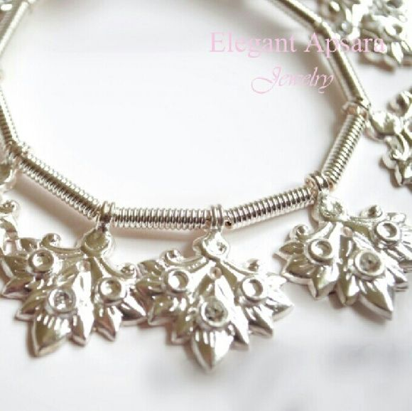 Khmer Silver Leaf Charm Bracelet Traditional Khmer Silver Leaf Charm Bracelet Traditional Wedding Jewelry Cambodian  This silver leaf charm bracelet (slerk tes) is a part of the traditional Khmer wedding bangle stack. This style is unique, rare and one of a kind. You will not find this in any fashion jewelry shops.  This item is handcrafted and imported from Cambodia. Bracelet is made with silver plated alloy wire to wrap around your wrist with spiral tube loops and leaf charms dangling…