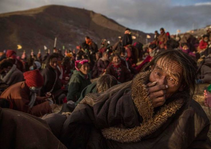 Daily Life, 2nd prize stories. Tibetan Buddhist nomads listen during the annual Bliss Dharma Assembly in Sertar county, Garze Tibetan Autonomous Prefecture, Sichuan province, China, Oct. 31, 2015.