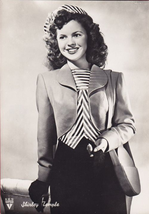 Shirley Temple looking chic in stripes, 1940s photo print ad movie star suit jacket skirt dress purse portrait war era