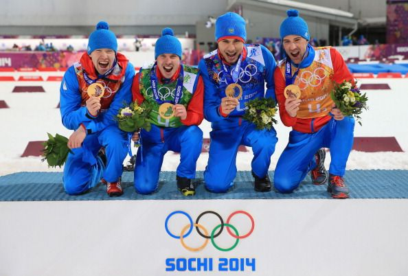 Alexey Volkov, Evgeny Ustyugov, Dmitry Malyshko and Anton Shipulin of Russia celebrate on the podium during flower ceremony for the Men's 4 x 7.5 km Relay (c) Getty Images