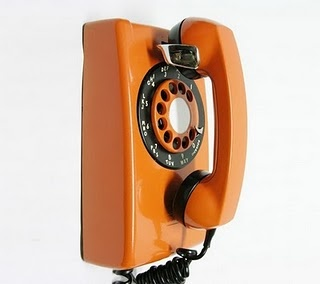 We need these vintage orange phones in the office!