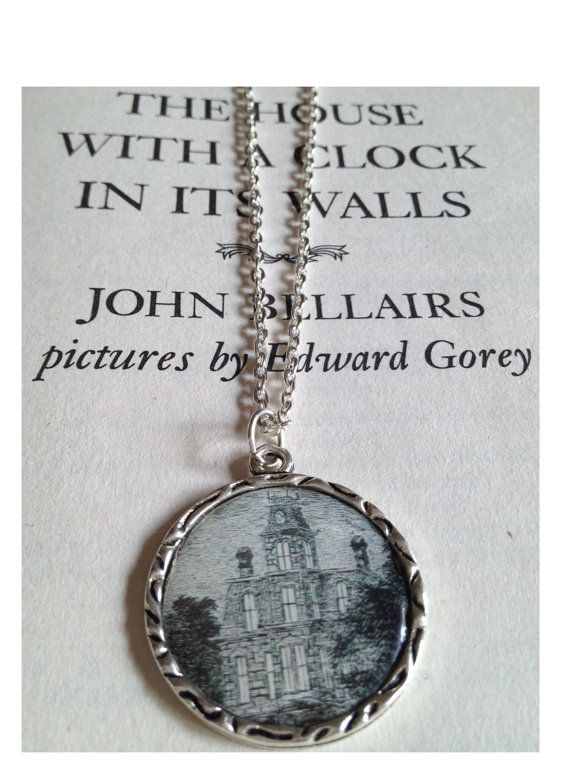 "A necklace based on ""The House With A Clock In Its Walls"". The pendant is an antique silver tone on an 18' silver chain."