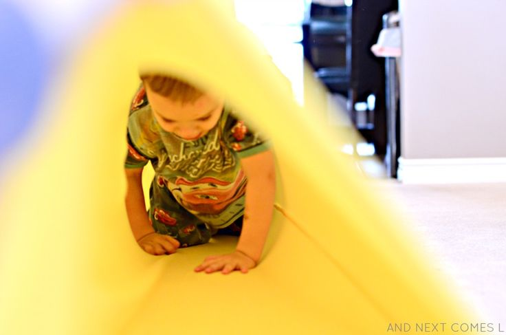Tutorial for sewing a homemade sensory tunnel - perfect for kids with autism and sensory processing disorder from And Next Comes L
