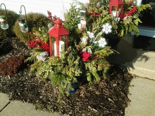 Evergreen flower pot with candle for outside decor