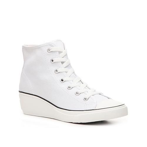 The retro-inspired Converse Chuck Taylor All Star mid-top sneaker has reached new heights! The Hi-Ness sneaker has a raised wedge heel for those ladies who want to add a few inches to their... More Details