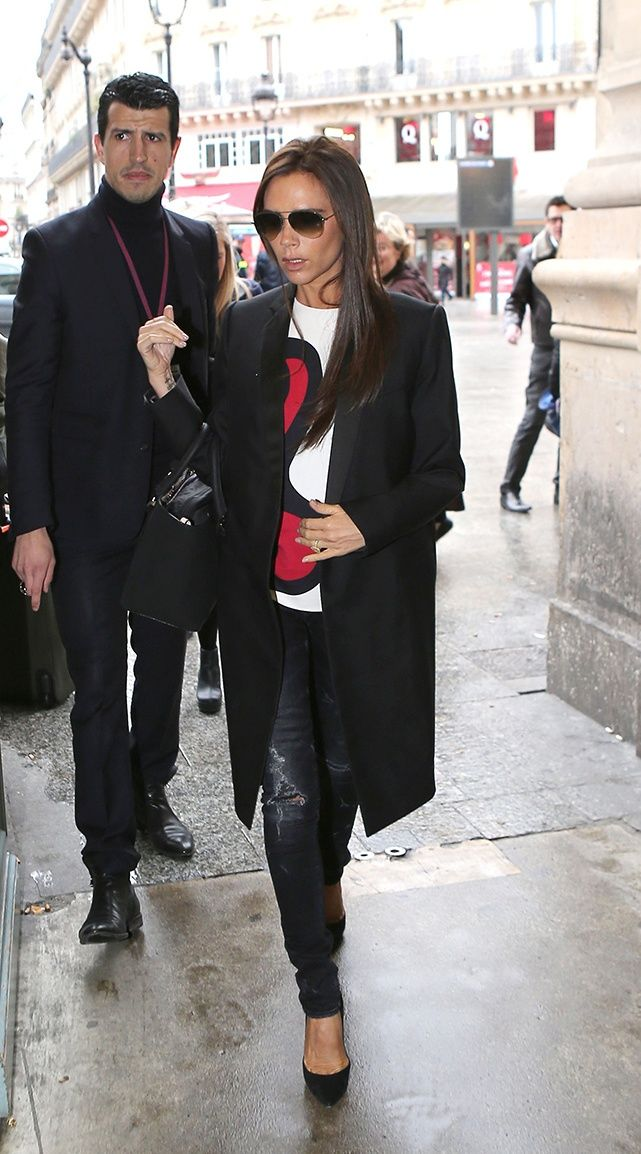 Vogue Daily — Victoria Beckham wears a VB coat, top, bag, and sunglasses, Casadei shoes in Paris, March 1st 2014