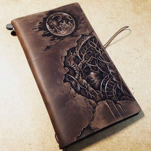 Pyrography on leather notebook cover. (Midori traveler's notebook brown)…