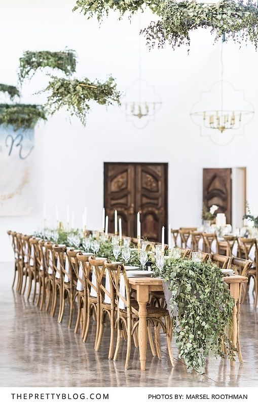 Wedding table setting with greenery runner. | Photo by Marsel Roothman