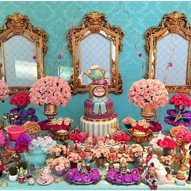 Ever After High party decorations - What a beautiful setup! Everything from the mirrors, flowers to the birthday cake. Very colorful and vibrant in a summery sort of way.
